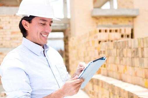 Civil engineer working with a tablet computer